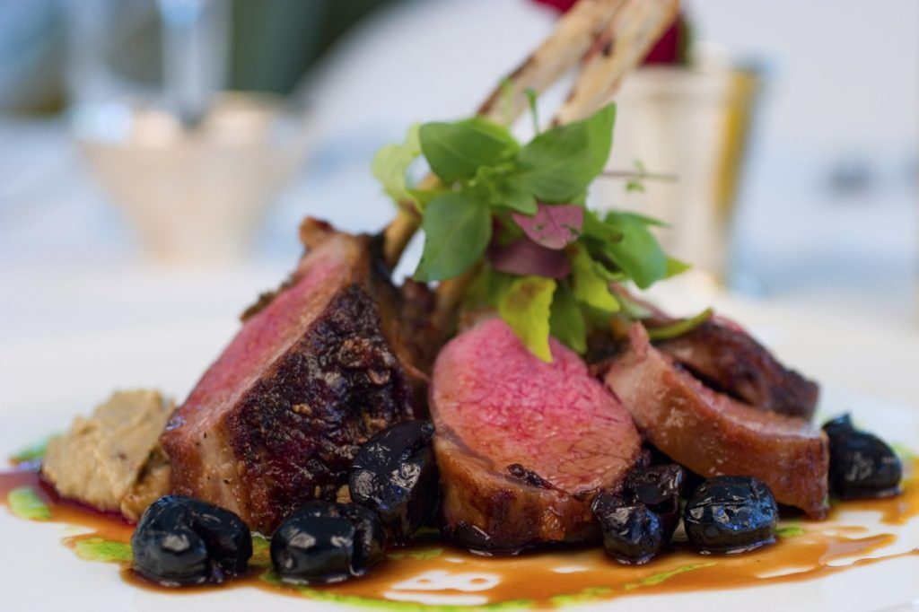 Grilled rack of lamb with black olives